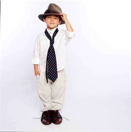 Boy Wearing Oversized Man's Clothing Stock Photo - Rights-Managed, Code: 822-05554845