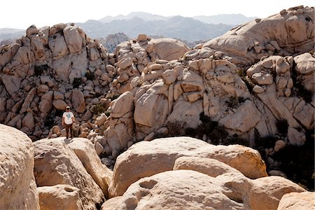 Back View of Man Standing on Rock Stock Photo - Rights-Managed, Code: 822-05554859