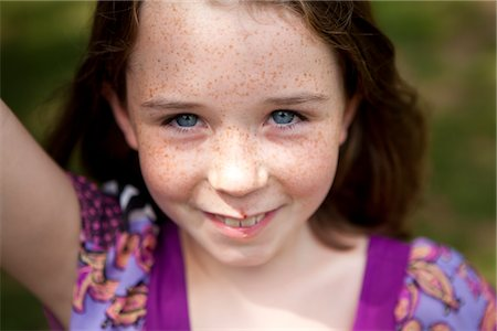Smiling Young Girl Stock Photo - Rights-Managed, Code: 822-05554853