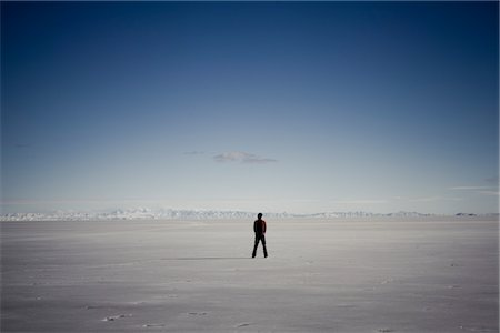 Man Standing In the Middle of Salt Flat Stock Photo - Rights-Managed, Code: 822-05554864