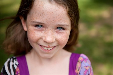Smiling Young Girl Stock Photo - Rights-Managed, Code: 822-05554869