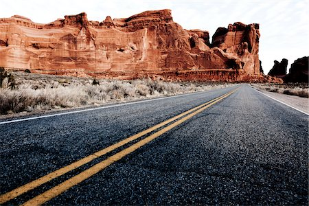 rugged landscape - Double Yellow Line on Highway and Sandstone Formations Stock Photo - Rights-Managed, Code: 822-05554877