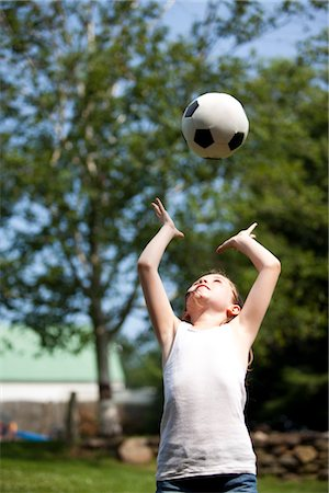 preteen girls stretching - Girl Throwing Football Above Head Stock Photo - Rights-Managed, Code: 822-05554897