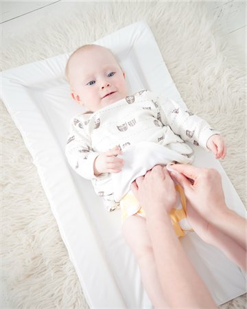 Mother Changing Baby Diaper Stock Photo - Rights-Managed, Code: 822-05554893