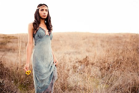 sexi women full body - Woman Standing on Field Holding Flowers Stock Photo - Rights-Managed, Code: 822-05554914