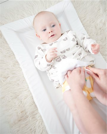 Mother Changing Baby Diaper Stock Photo - Rights-Managed, Code: 822-05554928