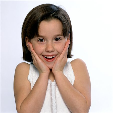 preteen  smile  one  alone - Smiling Girl with Hands on Face Stock Photo - Rights-Managed, Code: 822-05554923