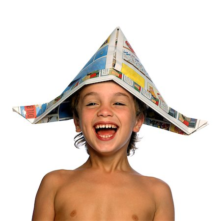 Boy Wearing Newspaper Hat Laughing Stock Photo - Rights-Managed, Code: 822-05554944