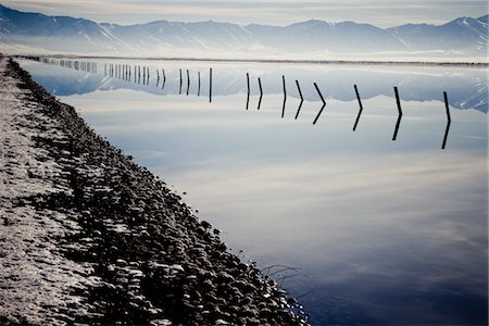 panoramic winter scene - Lakeshore with Submerged Fence Reflecting in Lake Stock Photo - Rights-Managed, Code: 822-05554954