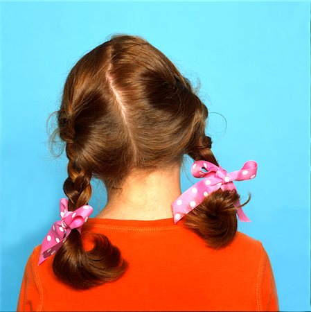 preteen girl pigtails - Back View of Girl's Head with Braids and Pink Ribbons Stock Photo - Rights-Managed, Code: 822-05554972