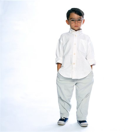 Boy Standing with Hands in Pockets Stock Photo - Rights-Managed, Code: 822-05554973
