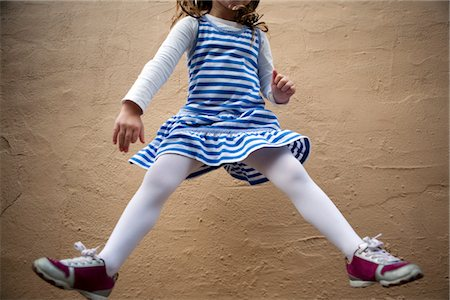 pantyhose kid - Girl Jumping Mid Air in front of Wall, Cropped Stock Photo - Rights-Managed, Code: 822-05554997