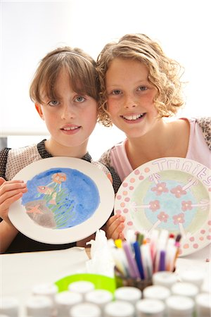 Two Girls Holding Hand Painted Plates Stock Photo - Rights-Managed, Code: 822-05554998
