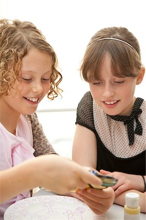 Two Girls Looking at Colour Sample Stock Photo - Rights-Managed, Code: 822-05554999