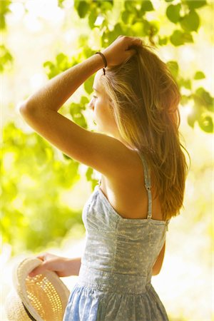 Teenage Girl with Hands on Hair  Outdoors Stock Photo - Rights-Managed, Code: 822-05555005