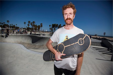 passion - Man Holding Skateboard in Skate Park Stock Photo - Rights-Managed, Code: 822-05555009