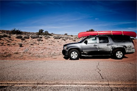 Parked Car with Red Canoe on Roof Stock Photo - Rights-Managed, Code: 822-05555012