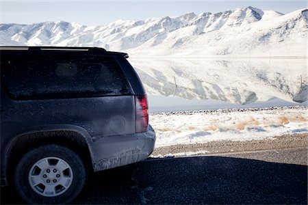 Car Parked on Road with Lake and Snow Covered Mountains Stock Photo - Rights-Managed, Code: 822-05555039