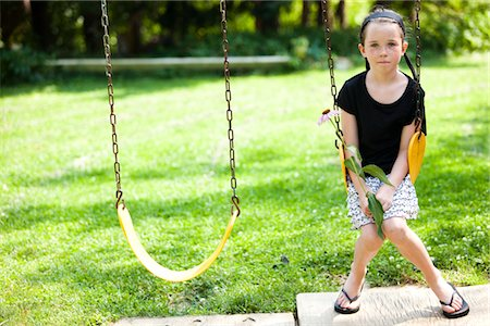 preteen thong - Girl Sitting on Swing Holding Flower Stock Photo - Rights-Managed, Code: 822-05555044