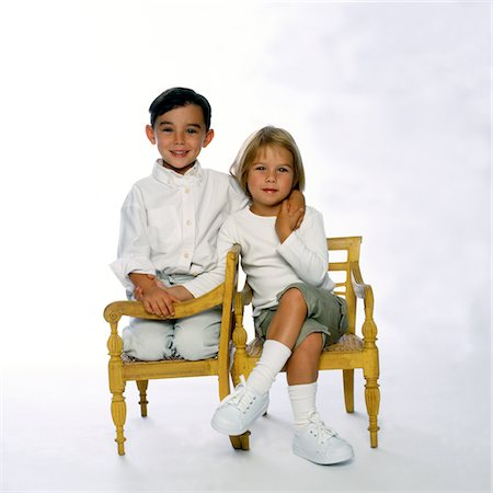Boy and Girl Sitting and Holding Hands Stock Photo - Rights-Managed, Code: 822-05555054