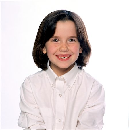Smiling Girl with Missing Tooth Stock Photo - Rights-Managed, Code: 822-05555056