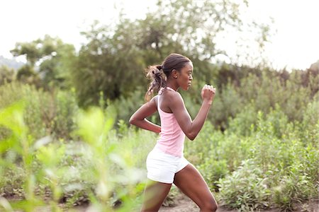 Young Woman Running Outdoors Stock Photo - Rights-Managed, Code: 822-05555068