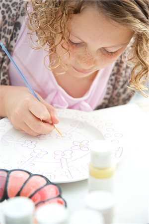 Girl Painting on Ceramic Plate Stock Photo - Rights-Managed, Code: 822-05555084