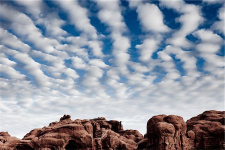 Sandstone Formations and Cloudy Blue Sky Stock Photo - Rights-Managed, Code: 822-05555100