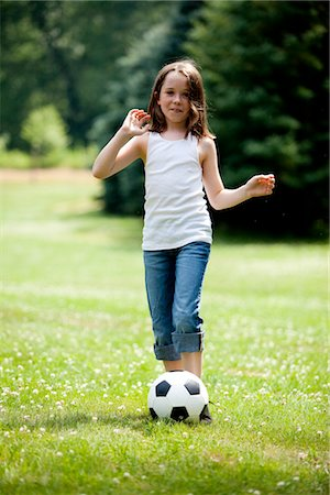 Young Girl Kicking Football in Park Stock Photo - Rights-Managed, Code: 822-05555142