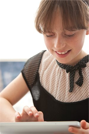 Young Girl Using Tablet PC Stock Photo - Rights-Managed, Code: 822-05555166
