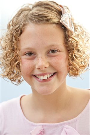 Smiling Young Girl Stock Photo - Rights-Managed, Code: 822-05555167
