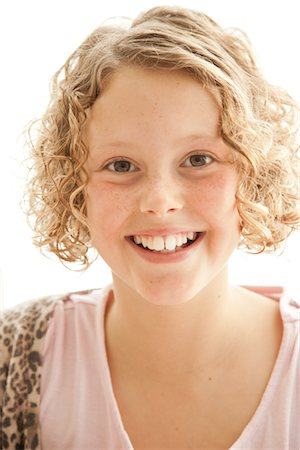 Smiling Young Girl Stock Photo - Rights-Managed, Code: 822-05555195