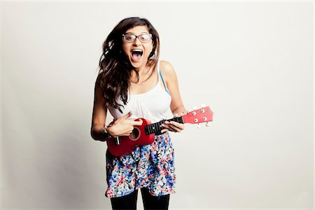 Laughing Woman Playing Small Guitar Stock Photo - Rights-Managed, Code: 822-05948286