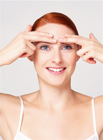 facial - Woman with Fingertips on Eyebrows Stock Photo - Rights-Managed, Code: 822-05948294