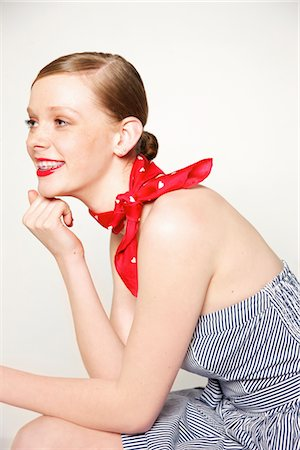 Young Woman with Dental Braces and Red Scarf around Neck Stock Photo - Rights-Managed, Code: 822-05948342
