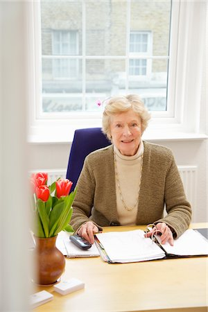 secretary desk - Senior Businesswoman Sitting at Desk Stock Photo - Rights-Managed, Code: 822-05948367