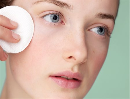 prevention - Young Woman Using Cleansing Cotton Pad Stock Photo - Rights-Managed, Code: 822-05948369