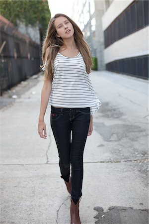 slim - Young Woman Walking on Street Stock Photo - Rights-Managed, Code: 822-05948379