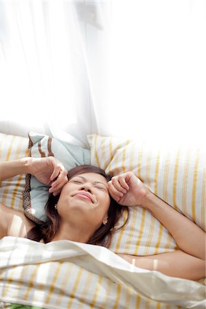 Woman in Bed Rubbing Face Stock Photo - Rights-Managed, Code: 822-05948387