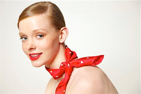 Young Woman with Dental Braces and Red Scarf around Neck Stock Photo - Rights-Managed, Code: 822-05948382