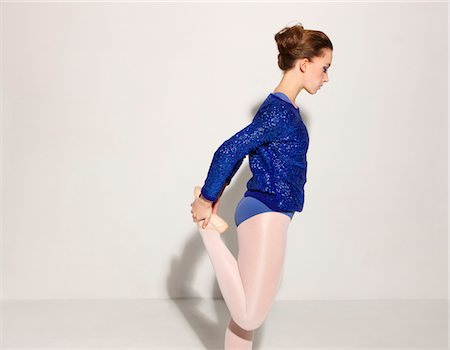 Side View of Ballet Dancer Stretching Leg Stock Photo - Rights-Managed, Code: 822-05948408