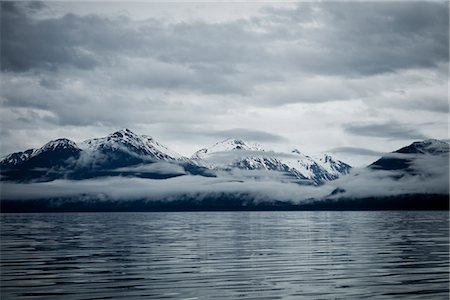 snow capped - Clouds Formation over Mountains, Admiralty Island, Alaska, USA Stock Photo - Rights-Managed, Code: 822-05948400