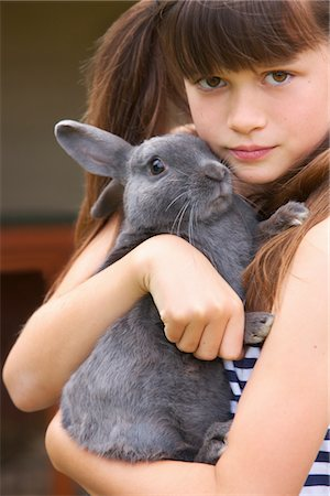 Girl Hugging Grey Rabbit Stock Photo - Rights-Managed, Code: 822-05948461