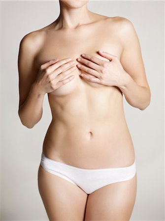 Woman Wearing White Underwear Covering her Breasts Stock Photo - Rights-Managed, Code: 822-05948490