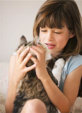 preteen girl pussy - Girl Playing with Cat Stock Photo - Rights-Managed, Code: 822-05948491