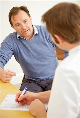 Patient Talking to Doctor Stock Photo - Rights-Managed, Code: 822-05948558