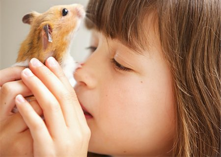 preteen girls faces photo - Girl Holding Hamster in front of Face Stock Photo - Rights-Managed, Code: 822-05948579