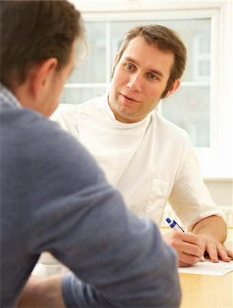 Doctor Taking Notes and Talking to Patient Stock Photo - Rights-Managed, Code: 822-05948592