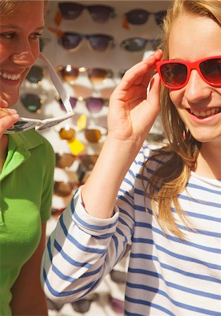 sunglasses - Smiling Teenage Girls Shopping for Sunglasses Stock Photo - Rights-Managed, Code: 822-05948604