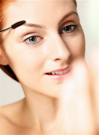 personal care - Woman Using Eyebrow Brush Stock Photo - Rights-Managed, Code: 822-05948602